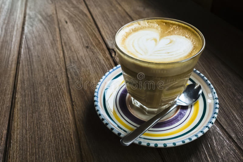 Cup of coffee on the wooden table royalty free stock photography