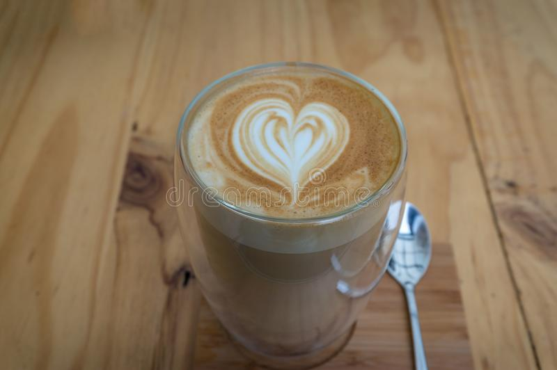 Cup of coffee on wooden table. Latte, cappuccino coffee drink with milk royalty free stock images
