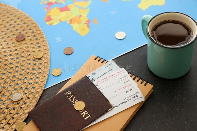 Cup of coffee, world map and passport with air tickets on table. Travel concept royalty free stock photos