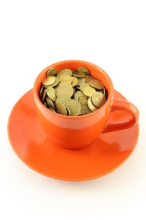 Cup of coins stock photos