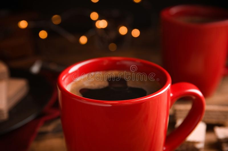 Cup of delicious black coffee on table. Closeup stock photography