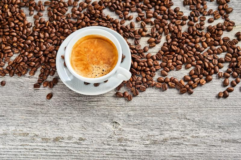 Cup of delicious espresso coffee with beans royalty free stock photos