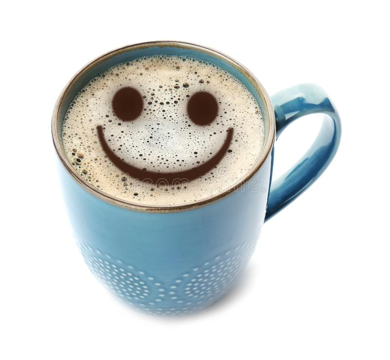 Cup of delicious hot coffee with foam and smile on white background. Happy morning, good mood. Inspiration royalty free stock image