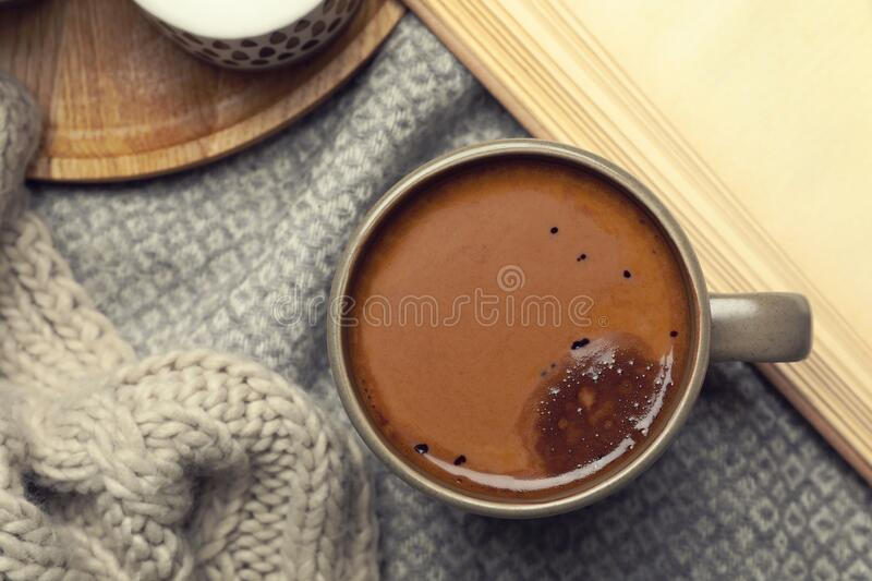 Cup of delicious hot winter drink on grey fabric. Winter drink. Cup of delicious hot winter drink on grey fabric, flat lay. Winter drink stock image