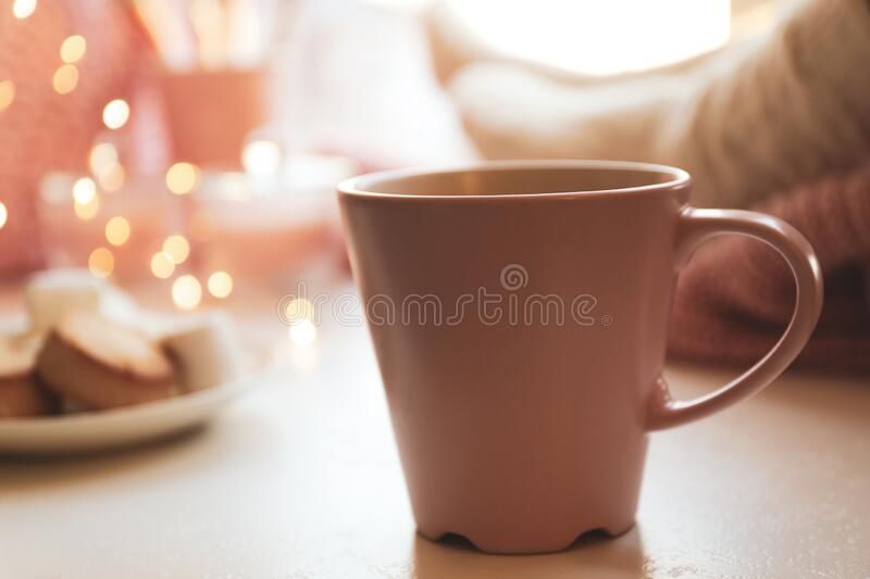 Cup of delicious hot winter drink on table. Cup of delicious hot winter drink on white table royalty free stock photos