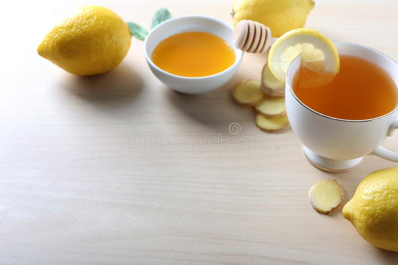Cup of delicious tea with ginger, lemon and honey on table royalty free stock photos