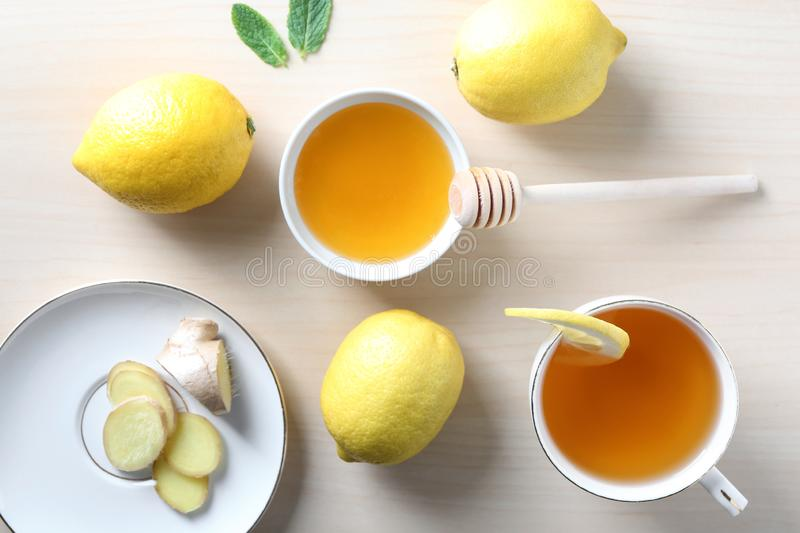 Cup of delicious tea with ginger, lemon and honey on table stock image