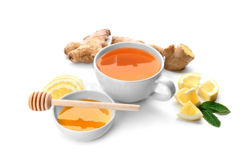 Cup of delicious tea with ginger, lemon and honey on white background stock photography