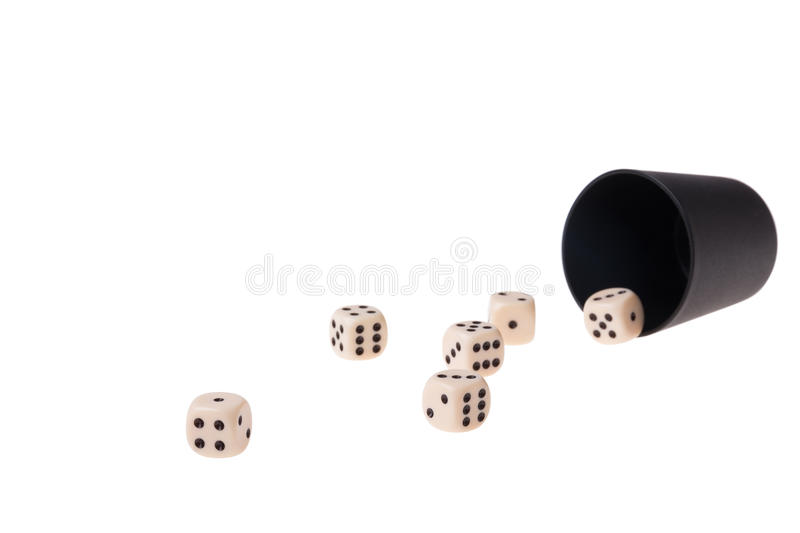 Cup and dices. Dice cup with several dices on a white background stock photos