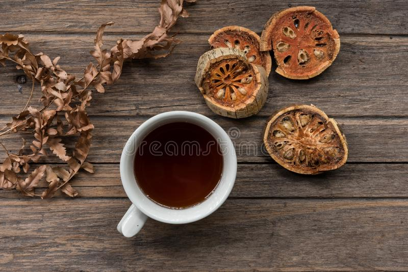 Cup of dried bael juice stock photos