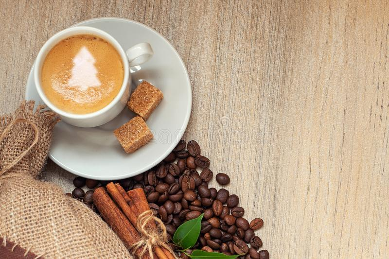Cup with espresso with coffee beans, burlap sack and cinnamon on stock photography