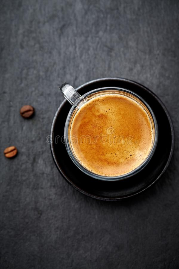 Cup of espresso and coffee beans. Top view. Copy space royalty free stock photo