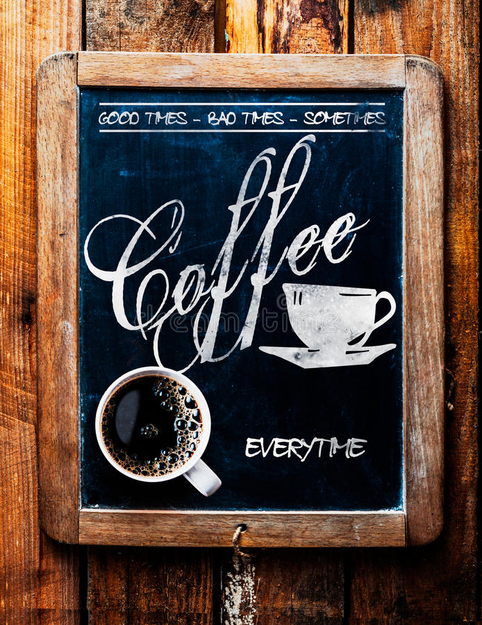 Cup of espresso coffee on a catchy sign. Saying - Good times, Bad times, Sometimes - Coffee Everytime - on an old school slate in a rustic coffee house or royalty free stock photography