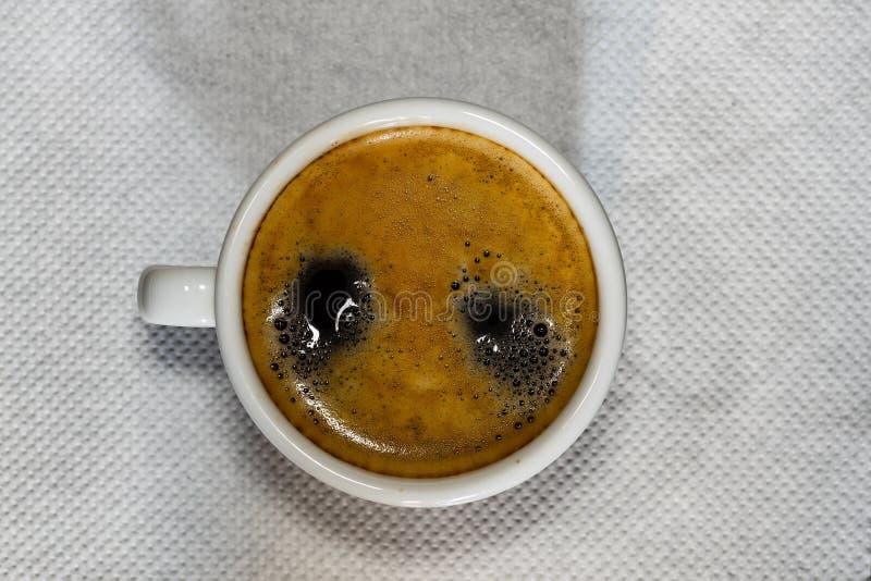 Cup of Espresso coffee on white napkin, espresso creme. Coffe royalty free stock photo