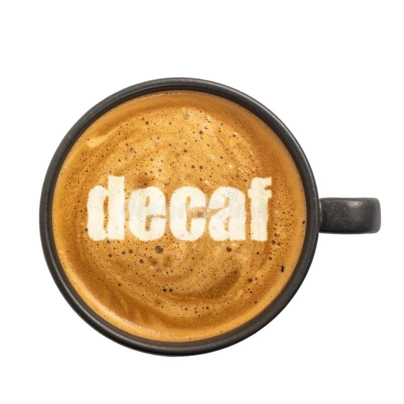 Cup of espresso with decaf inscription on coffee foam isolated on white background. Top view royalty free stock image