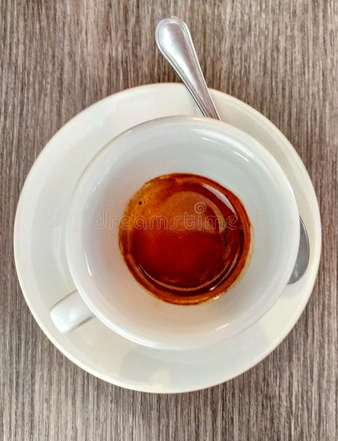 A cup of espresso. in Italy, especially in the south, there is a cult of drinking coffee at the bar. a good cup of coffee and star. Coffee espresso machine stock image