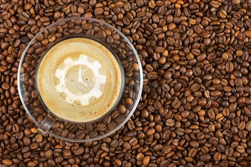 Cup of espresso with like sign on coffee foam on coffee beans background. With copy space royalty free stock photo