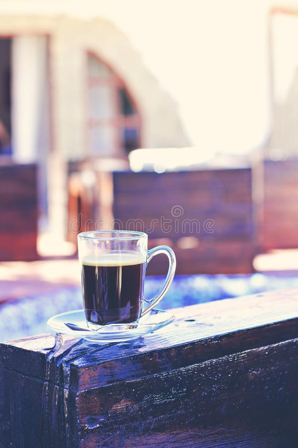 A cup of espresso and a pool in the background. Morning coffee. Summer Breakfast. Coffee at the resort stock images