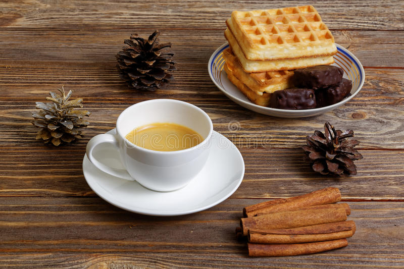 Cup of espresso, waffles and chocolate candy stock image
