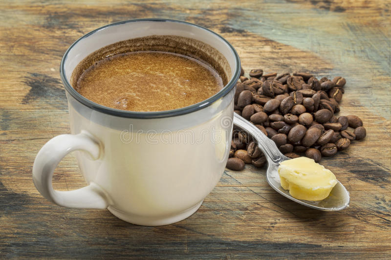 Cup of fatty coffee with butter. A cup of fresh fatty coffee with butter and coconut oil - ketogenic diet concept royalty free stock images