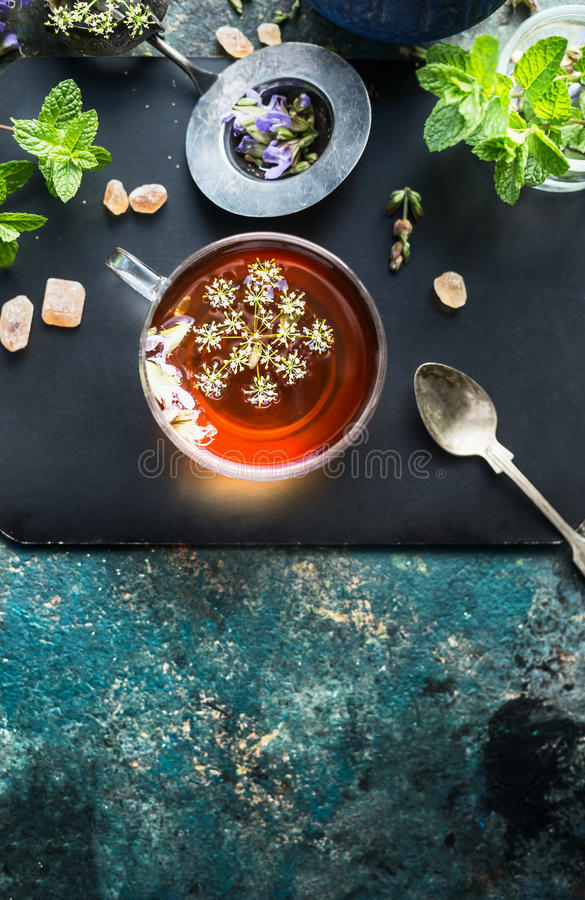Cup with fennel tea on dark rustic background stock photography