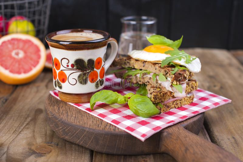 A cup of fragrant coffee and a glass of water. Toast with egg and salad for breakfast. Tasty and healthy food. Diet. Good morning. stock photos
