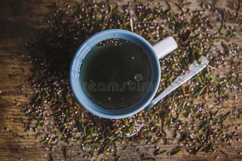 Cup with fragrant, flowered black tea on a wooden background. Breakfast, health, herbal therapy, healthy food. Concept stock photography
