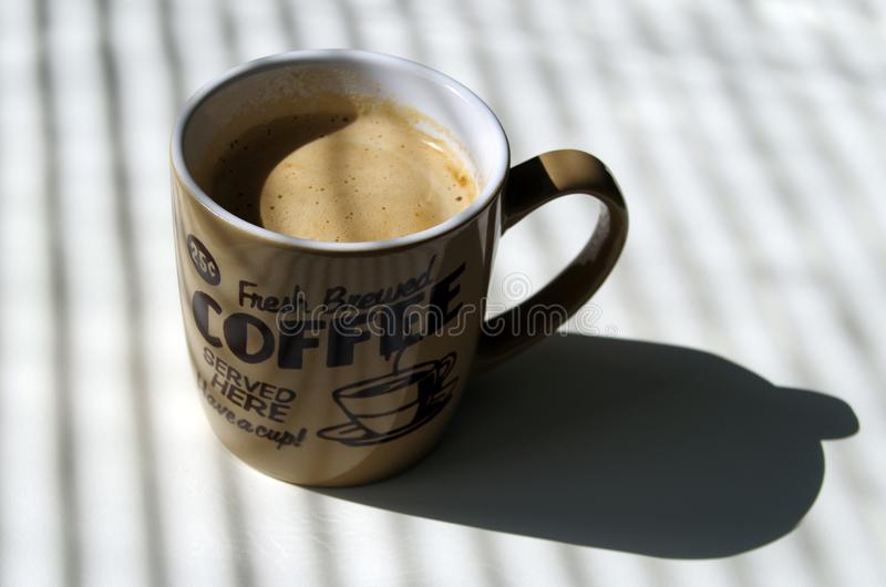 A cup of fresh brewed coffee royalty free stock images