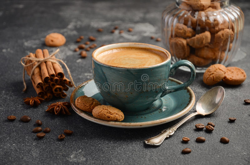 Cup of fresh coffee with Amaretti cookies on dark background royalty free stock photos