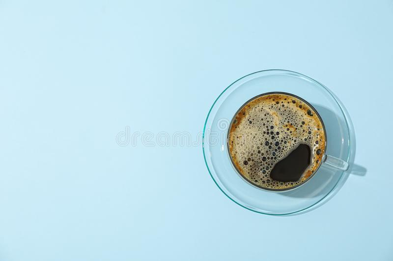 Cup of fresh coffee on color background, space for text. And top view stock photos