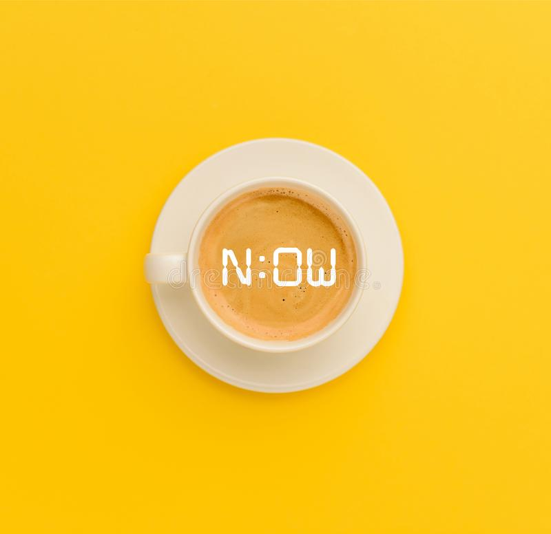 Cup of fresh coffee. Top view of cup of fresh hot coffee isolated on yellow royalty free stock photo