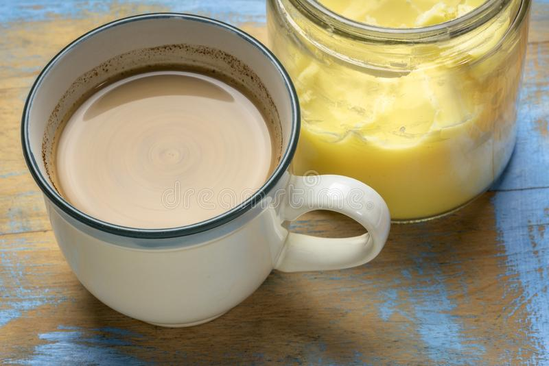 Cup of fresh fatty coffee with ghee. Clarified butter, MCT oil and cinnamon - ketogenic diet concept royalty free stock photo