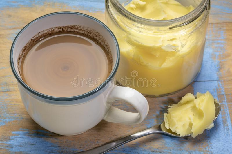 Cup of fresh fatty coffee with ghee. Clarified butter, MCT oil and cinnamon - ketogenic diet concept royalty free stock images