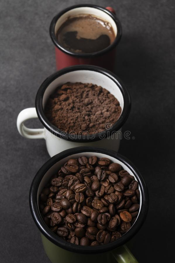 Cup of fresh raw organic coffee with beans. And ground powder stock photos