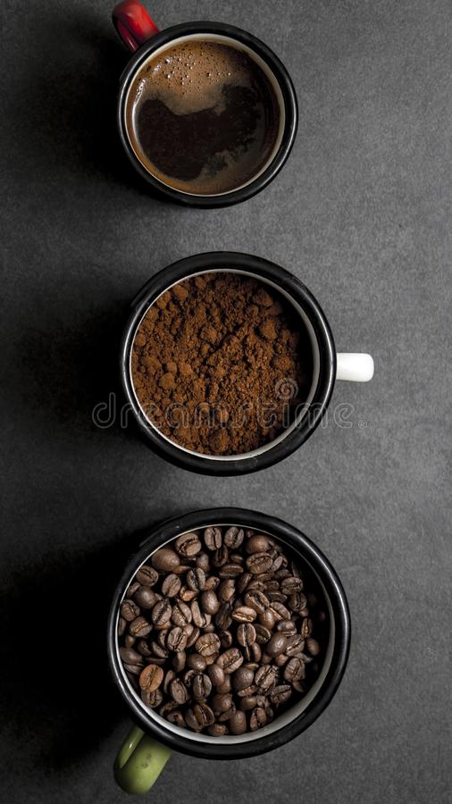 Cup of fresh raw organic coffee with beans. And ground powder royalty free stock photos