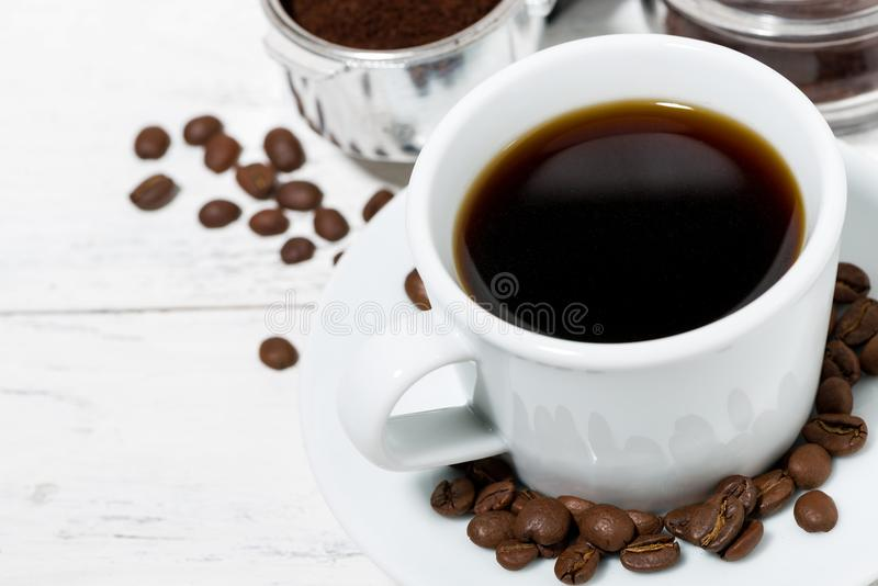 Cup of freshly brewed black coffee on a white table royalty free stock photos
