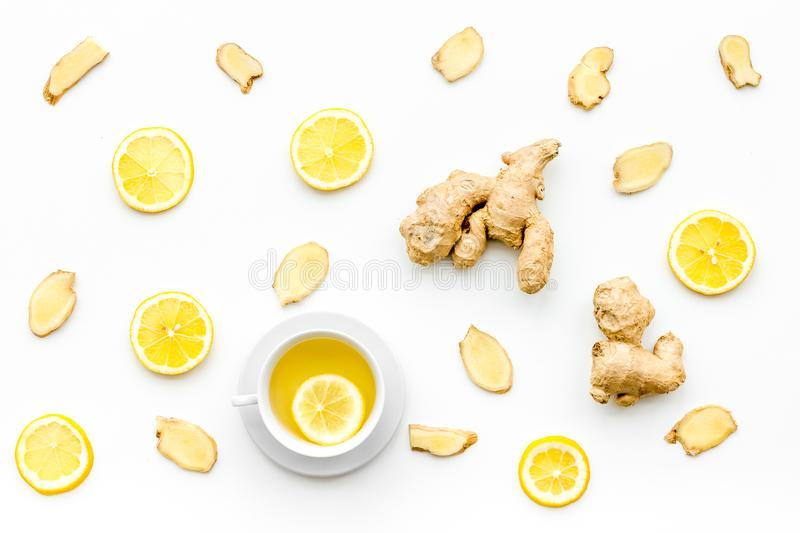 Cup of ginger tea near ginger root on white background top view pattern royalty free stock photos