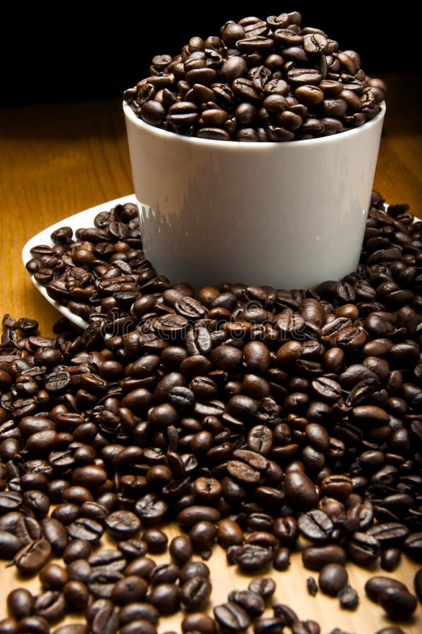 Cup of grains of coffee. Representative of hight levels of caffeine royalty free stock image