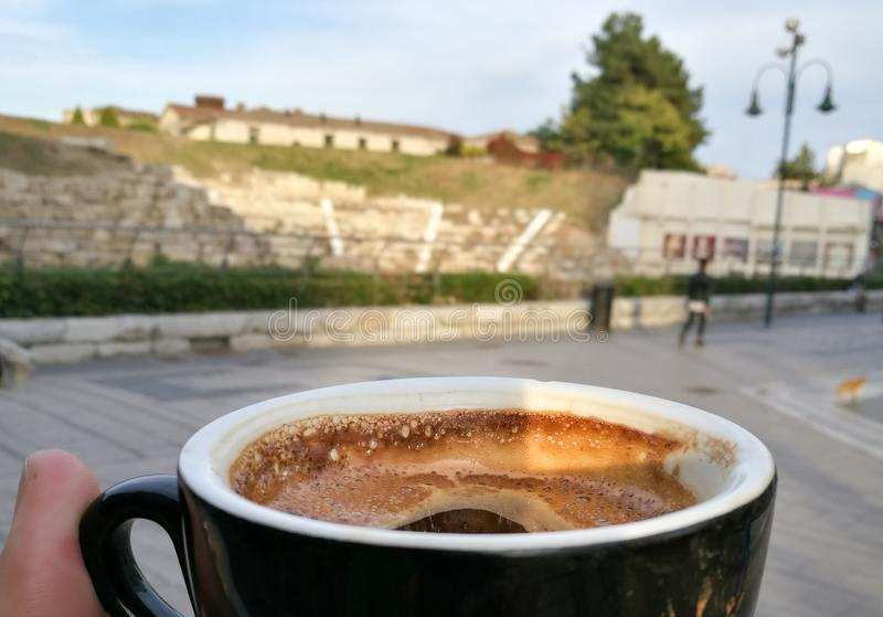 Greek coffee with the first ancient theater of Larissa royalty free stock photo