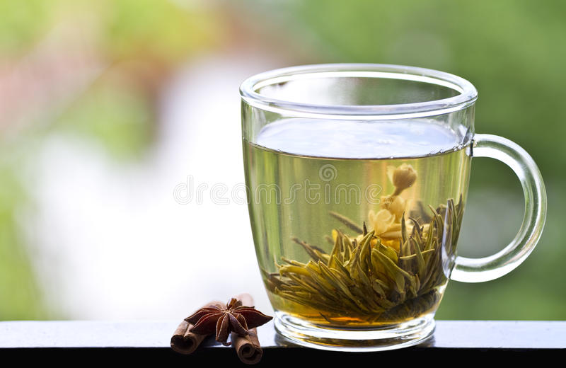Cup of green tea with jasmine