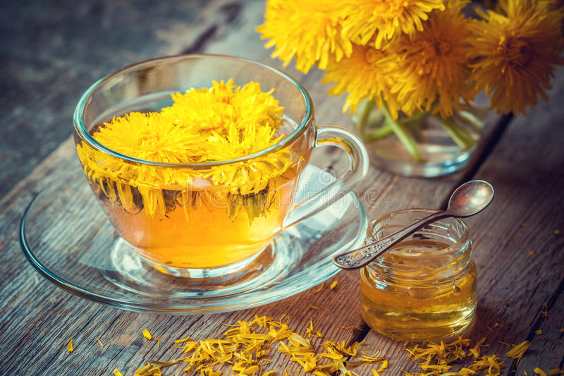 Cup of healthy dandelion tea and honey. royalty free stock photos