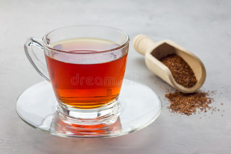Cup of healthy herbal rooibos red tea in glass cup stock photos
