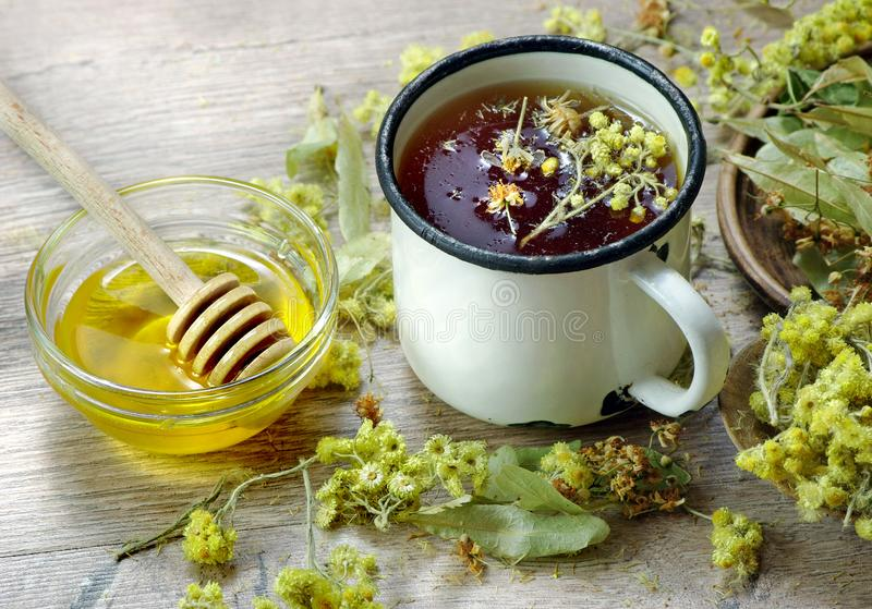 Cup of herbal tea and honey. medicinal herbs. remedy for flu and cold. Cup of herbal tea and honey. medicinal herbs. close-up. remedy for flu and cold stock image