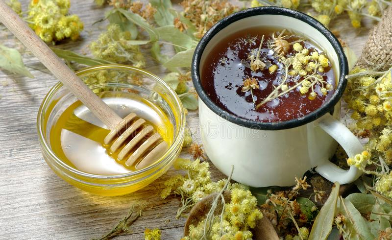 Cup of herbal tea and honey. medicinal herbs. remedy for flu and cold. Cup of herbal tea and honey. medicinal herbs. close-up. remedy for flu and cold royalty free stock photo