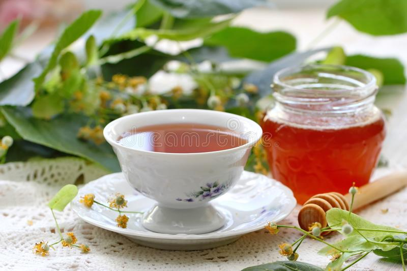 Herbal tea with linden flowers, honey and lemon stock photos
