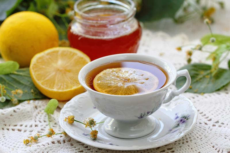Herbal tea with linden flowers, honey and lemon royalty free stock images