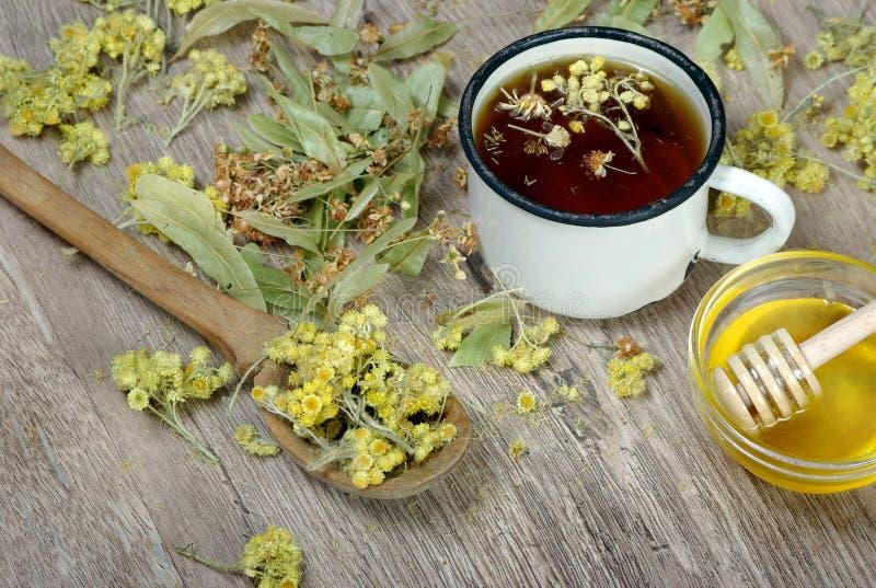 Cup of herbal tea. medicinal herbs. close-up. remedy for flu and cold. Cup of herbal tea. medicinal herbs. remedy for flu and cold stock photos