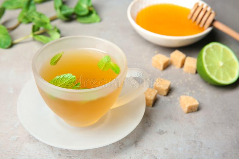 Cup of hot aromatic tea with mint on table royalty free stock photos