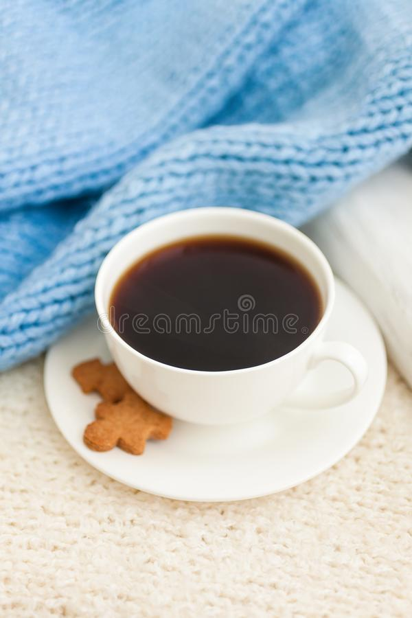 Cup of hot black coffee with christmas gingerbread cookie man. Traditional holiday sweet. Winter background stock photography