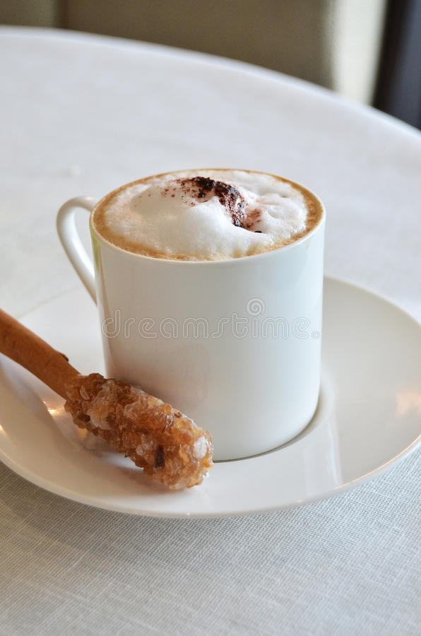 Cup of hot Cappuccino coffee on table royalty free stock photos